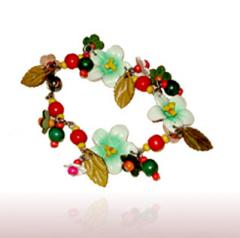 Blooming flowers with leaves and beads leather