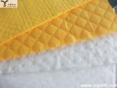 Oil absorbing fabric