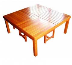 Versatile, low wooden table seats 2