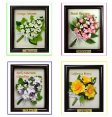 Handcrafted miniature clay flower in frame