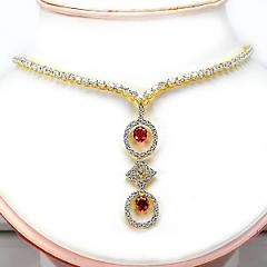 Gold necklase with yellow ruby and diamond