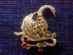 Semi-precious gems with ruby and diamond brooch