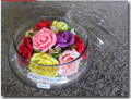 Soap flowers in glass container