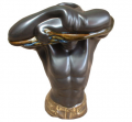 Statue man candle holder.
