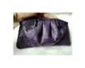 Crocodile leather cosmetic pouch in purple