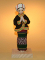 Porcelain doll woman in traditional dress